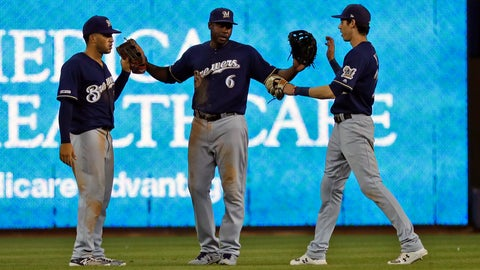 <p>               Milwaukee Brewers' Trent Grisham, left, Lorenzo Cain, center, and Christian Yelich celebrate after they defeated the Miami Marlins in a baseball game, Monday, Sept. 9, 2019, in Miami. (AP Photo/Wilfredo Lee)             </p>