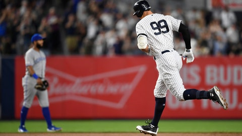 <p>               New York Yankees' Aaron Judge rounds second base after hitting a home run during the fourth inning of the team's baseball game against the Toronto Blue Jays, Friday, Sept. 20, 2019, in New York. (AP Photo/Sarah Stier)             </p>
