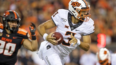 <p>               FILE - In this Aug. 30, 2019, file photo, Oklahoma State quarterback Spencer Sanders is shown during an NCAA football game against Oregon State in Corvallis, Ore. He wasn't named the starter until right before kickoff, but after a winning a lengthy battle with Hawaii grad transfer Dru Brown to take over as Oklahoma State's quarterback, redshirt freshman Spencer Sanders enjoyed an impressive debut in the Cowboys' 52-36 victory over Oregon State Friday night. (AP Photo/Craig Mitchelldyer, File)             </p>