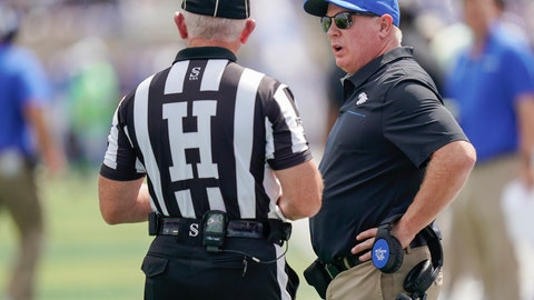 <p>               Kentucky head coach Mark Stoops speaks with an official during an NCAA college football game against Toledo, Saturday, Aug. 31, 2019, in Lexington, Ky. (AP Photo/Bryan Woolston)             </p>