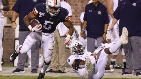 <p>               Virginia running back Lamont Atkins (5) shakes a tackle from Old Dominion safety Harrell Blackmon (7) during the fourth quarter of an NCAA college football game in Charlottesville, Va., Saturday, Sept. 21, 2019. (AP Photo/Andrew Shurtleff)             </p>
