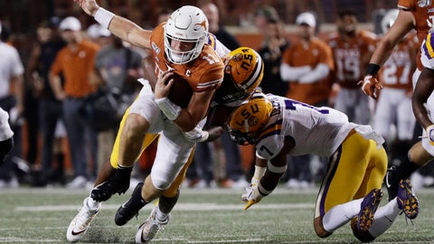 <p>               Texas quarterback Sam Ehlinger (11) is hit by LSU defensive end Justin Thomas (93) during the second half of an NCAA college football game Saturday, Sept. 7, 2019, in Austin, Texas. (AP Photo/Eric Gay)             </p>