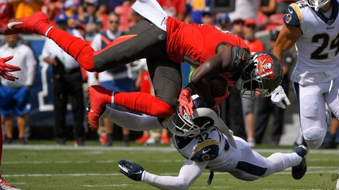 <p>               Tampa Bay Buccaneers wide receiver Chris Godwin, top, is tackled by Los Angeles Rams free safety Eric Weddle during the first of an NFL football game Sunday, Sept. 29, 2019, in Los Angeles. (AP Photo/Mark J. Terrill)             </p>