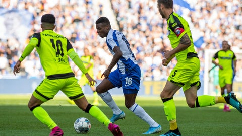 <p>               In this Saturday, Sept. 21, 2019 photo, Berlin's Javairo Dilrosun, center, challenges for the ball with Paderborn's Cauly Oliveira Souza, left, and Christian Strohdiek, right, during the German Bundesliga soccer match between Hertha BSC Berlin and SC Paderborn 07, at the Olympic Stadion in Berlin. ( Soeren Stache/dpa via AP)             </p>