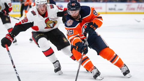 <p>               FILE - In this March 23, 2019, file photo, Ottawa Senators' Thomas Chabot, left, checks Edmonton Oilers' Sam Gagner, right, during second-period NHL hockey game action in Edmonton, Alberta. Chabot has agreed to an eight-year, $64 million contract extension. (Jeff McIntosh/The Canadian Press via AP, File)             </p>