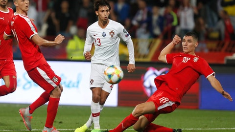 <p>               Portugal's Joao Felix, centre, kicks the ball ahead of Serbia's Nemanja Matic, left, and Serbia's Nikola Milenkovic during the Euro 2020 group B qualifying soccer match between Serbia and Portugal, on the stadium Rajko Mitic in Belgrade, Serbia, Saturday, Sept. 7, 2019. (AP Photo/Darko Vojinovic)             </p>