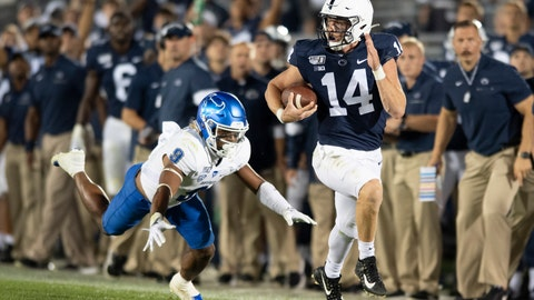 <p>               Penn State quarterback Sean Clifford (14) sprints away from Buffalo safety Joey Banks (9) on along gain during the third quarter of an NCAA college football game in State College, Pa., Saturday, Sept. 7, 2019. (AP Photo/Barry Reeger)             </p>