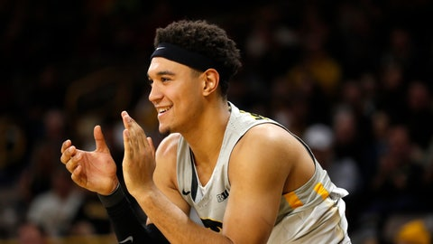 <p>               FILE - In this Dec. 6, 2018, file photo, Iowa forward Cordell Pemsl celebrates during the second half of an NCAA college basketball game in Iowa City, Iowa. Pemsl has been arrested for suspected drunken driving and suspended from the team. The Hawkeyes say in news release that the team suspended Pemsl indefinitely following his arrest early Friday Sept. 20, 2019. (AP Photo/Charlie Neibergall File)             </p>