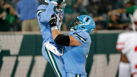 <p>               Houston wide receiver Bryson Smith, left, celebrates his touchdown with offensive lineman Christian Montano during the first half of an NCAA college football game against Tulane in New Orleans, Thursday, Sept. 19, 2019. (AP Photo/Gerald Herbert)             </p>