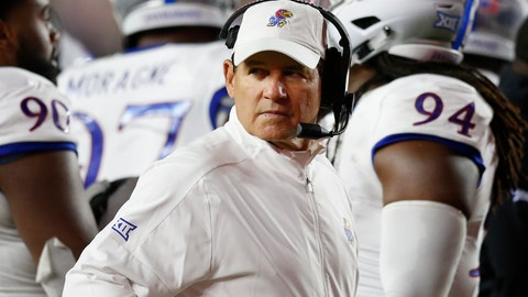 <p>               Kansas head coach Les Miles stand swith his team during a timeout in the second half of an NCAA college football game against Boston College in Boston, Friday, Sept. 13, 2019. (AP Photo/Michael Dwyer)             </p>