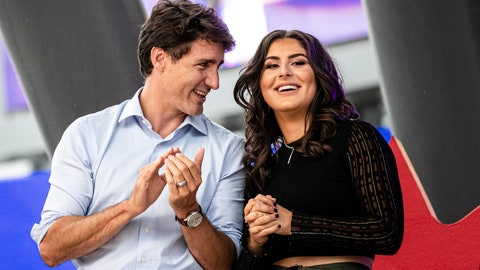 <p>               Canadian Prime Minister and Liberal leader Justin Trudeau speaks with Canadian tennis player and U.S. Open winner Bianca Andreescu on stage during a rally for her in Mississauga, Ontario, Sunday, Sept. 15, 2019. (Christopher Katsarov/The Canadian Press via AP)             </p>
