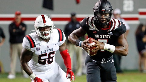 <p>               North Carolina State's Matthew McKay (7) scrambles away from Ball State's Shannon Hall (56) during the first half of an NCAA college football game in Raleigh, N.C., Saturday, Sept. 21, 2019. (AP Photo/Karl B DeBlaker)             </p>
