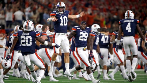<p>               Auburn quarterback Bo Nix (10) celebrates with teammates after Auburn came from behind to defeat Oregon following an NCAA college football game, Saturday, Aug. 31, 2019, in Arlington, Texas. Auburn won 27-21. (AP Photo/Ron Jenkins)             </p>