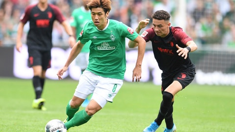 <p>               Bremen's Yuya Osako, left, and Augsburg's Ruben Vargas challenge for the ball during the Bundesliga soccer match between Werder Bremen and FC Augsburg in Bremen, Germany, Sunday, Sept. 1, 2019. (Carmen Jaspersen/dpa via AP)             </p>