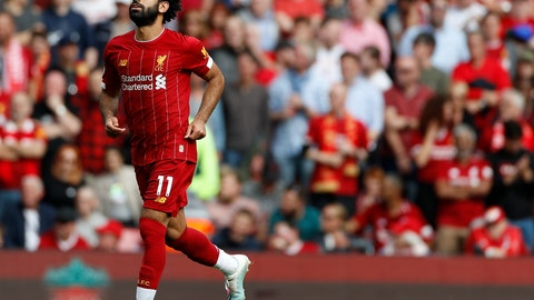 <p>               Liverpool's Mohamed Salah celebrates after scoring his sides third goal during the English Premier League soccer match between Liverpool and Newcastle at Anfield stadium in Liverpool, England, Saturday, Sept. 14, 2019. (AP Photo/Rui Vieira)             </p>