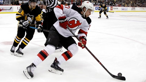 <p>               FILE - In this Jan. 28, 2019, file photo, New Jersey Devils' Pavel Zacha, center, skates during an NHL hockey game against the Pittsburgh Penguins in Pittsburgh, Monday, Jan. 28, 2019. Devils general manager Ray Shero says he is still attempting to sign Zacha amid concerns the former first-round draft pick will play in the Kontinental Hockey League this season. (AP Photo/Gene J. Puskar, File)             </p>