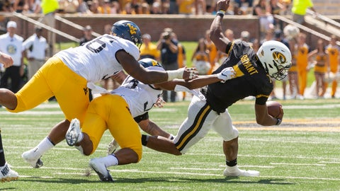 <p>               Missouri quarterback Kelly Bryant, right, slips away from West Virginia's Adam Stilley, left, and Josh Chandler, center, as he scrambles during the first half of an NCAA college football game Saturday, Sept. 7, 2019, in Columbia, Mo. Missouri won the game 38-7. (AP Photo/L.G. Patterson)             </p>