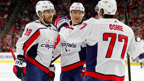 <p>               Washington Capitals' T.J. Oshie (77) celebrates his goal with teammate Chandler Stephenson (18) and Jakub Vrana (13) of Czech Republic during the first period of an NHL preseason hockey game against the Carolina Hurricanes, in Raleigh, N.C., Sunday, Sept. 29, 2019. (AP Photo/Karl B DeBlaker)             </p>
