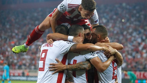 <p>               Olympiakos' players celebrate their side's second goal, scored by Mathieu Valbuena during the Champions League group B soccer match between Olympiakos and Tottenham, at the Georgios Karaiskakis stadium, in Piraeus port, near Athens, Wednesday, Sept. 18, 2019. (AP Photo/Thanassis Stavrakis)             </p>