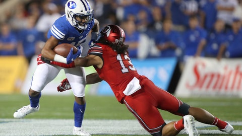 <p>               BYU wide receiver Aleva Hifo (15) is tackled by Utah linebacker Francis Bernard (13) during the first half during an NCAA college football game Thursday, Aug. 29, 2019, in Provo, Utah. (AP Photo/George Frey)             </p>