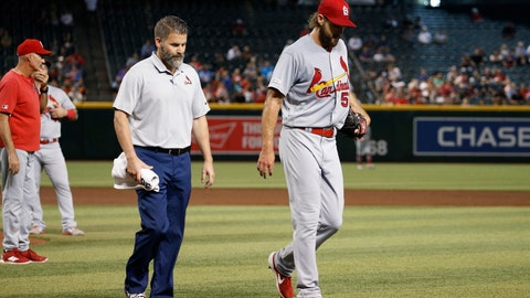 <p>               Injured St. Louis Cardinals starting pitcher Michael Wacha, right, walks off the field with head athletic trainer Adam Olsen, middle, as Cardinals pitching coach Mike Maddux, left, looks to the bullpen during the second inning of a baseball game against the Arizona Diamondbacks Wednesday, Sept. 25, 2019, in Phoenix. (AP Photo/Ross D. Franklin)             </p>
