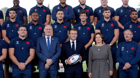 <p>               France's President Emmanuel Macron, center, French Rugby Federation President Bernard Laporte, center left, and French Sports Minister Roxana Maracineanu, center right, pose for a picture with French national rugby team players ahead of the upcoming Rugby Wcup, at the National Rugby Center in Marcoussis, south of Paris, Thursday, Sept.5, 2019. The French rugby team is preparing for the upcoming 2019 World Cup in Japan. (AP Photo/Christophe Ena, Pool)             </p>