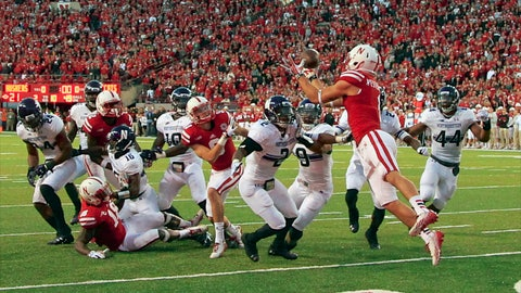<p>               FILE - In this Nov. 2, 2013, file photo, Nebraska wide receiver Jordan Westerkamp (1) catches the game-winning touchdown over Northwestern center back Dwight White (2) , safety Jimmy Hall (9) and linebacker Chi Chi Ariguzo (44) with seconds to go in the second half of an NCAA college football game against Northwestern in Lincoln, Neb. Nebraska won 27-24. Nebraska and Northwestern have split eight games since the Cornhuskers joined the Big Ten in 2011. A combined 21 points separate the teams in those eight games. Northwestern has won the last two meetings in overtime. (AP Photo/Nati Harnik, File)             </p>