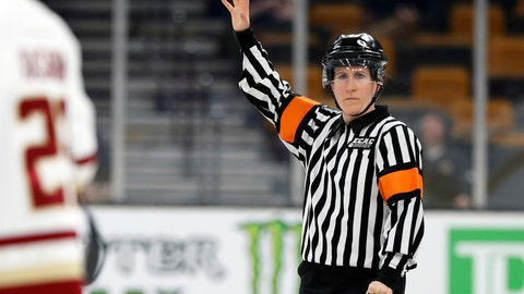 <p>               FILE - In this Feb 4, 2019, file photo, referee Katie Guay watches a Boston College line change during a Beanpot Tournament NCAA college hockey game against Harvard in Boston.  Guay and Kirsten Walsh were among four females selected by the NHL on Friday, Sept. 6, 2019, to be the first women to work as on-ice officials at several prospect tournaments taking place across the country this weekend. The other two women selected were Kelly Cooke and Kendall Hanley. (AP Photo/Winslow Townson, FIle)             </p>