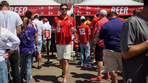 <p>               North Carolina State alumni Matthew DiGioia carries a beer during an NCAA college football game between North Carolina State and East Carolina at Carter Finley Stadium in Raleigh, N.C., Saturday, Aug 31, 2019.  There's a growing trend at Atlantic Coast Conference football games: alcohol sales to the general public.  Now everyone can enjoy their beverage of choice at most ACC stadiums, not just boosters and donors.  (Bryan Cereijo/The News & Observer via AP)             </p>