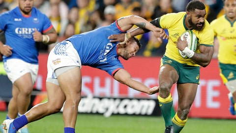 <p>               Australia's Marika Koroibete, right, breaks the tackle of Samoa's Alapati Leiua on his way to scoring a try during their rugby union test match in Sydney, Saturday, Sept. 7, 2019. (AP Photo/Rick Rycroft)             </p>