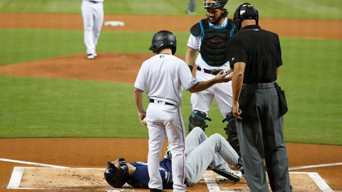 <p>               Milwaukee Brewers' Christian Yelich (22) lies on the ground after an injury during an at-bat, as Miami Marlins catcher Jorge Alfaro, rear, home plate umpire Kerwin Danley and a bat boy stand next to him during the first inning of a baseball game, Tuesday, Sept. 10, 2019, in Miami. Yelich broke his right kneecap on a foul ball and will miss the rest of the regular season. (AP Photo/Wilfredo Lee)             </p>
