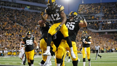 <p>               Iowa wide receiver Brandon Smith (12) celebrates with teammates after catching a touchdown pass during the first half of an NCAA college football game against Miami of Ohio, Saturday, Aug. 31, 2019, in Iowa City, Iowa. (AP Photo/Charlie Neibergall)             </p>
