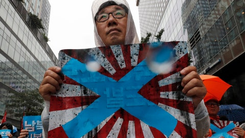 "<p>               FIEL - In this Aug. 15, 2019, file photo, South Korean protesters hold Japanese rising sun flags during a rally to mark the South Korean Liberation Day from Japanese colonial rule, in downtown Seoul, South Korea. South Korea has formally asked the International Olympic Committee to ban the Japanese ""rising sun"" flag at next year's Tokyo Games, calling it a symbol of Japan's brutal wartime past. (AP Photo/Lee Jin-man, File)             </p>"