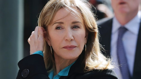 <p>               FILE - In this April 3, 2019 file photo, actress Felicity Huffman arrives at federal court in Boston to face charges in a nationwide college admissions bribery scandal. Huffman, who pleaded guilty to a single count of conspiracy and fraud in May, is returning for sentencing in federal on Friday, Sept. 13, 2019 court in Boston. (AP Photo/Charles Krupa, File)             </p>