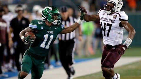 <p>               Tulane running back Amare Jones (11) fights his way past Missouri State safety Kam Carter (47) for a long gain during an NCAA college football game Saturday, Sept. 14, 2019, in New Orleans. (A.J. Sisco/The Advocate via AP)             </p>