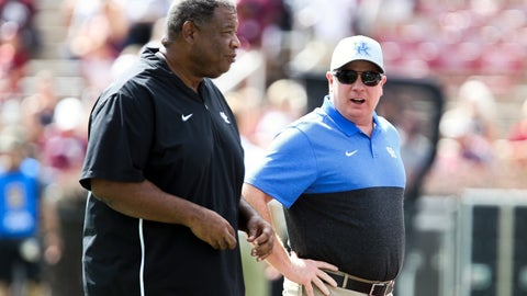 <p>               Kentucky head coach Mark Stoops talks with Kentucky associate head coach Vince Marrow during warmups prior to an NCAA college football game against Mississippi State, Saturday, Sept. 21, 2019, in Starkville, Miss. (AP Photo/Kelly Donoho)             </p>