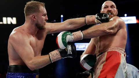 <p>               Otto Wallin, left, of Sweden, punches Tyson Fury, of England, during their heavyweight boxing match Saturday, Sept. 14, 2019, in Las Vegas. (AP Photo/Isaac Brekken)             </p>