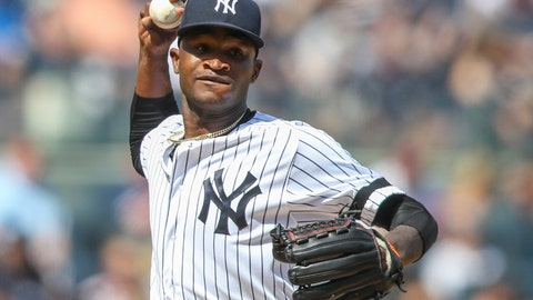 """<p>               FILE - This is an Aug. 31, 2019, file photo showing New York Yankees pitcher Domingo German throwing to first in a pickoff attempt during the fifth inning of a baseball game against the Oakland Athletics, in New York. Yankees star pitcher Domingo Germán has been placed on administrative leave by Major League Baseball because of domestic violence. MLB did not give details in its statement Thursday, Sept. 19, 2019, but said the leave """"may last up to seven days, barring an extension."""" (AP Photo/Mary Altaffer, File)             </p>"""
