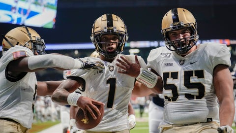 <p>               Army quarterback Jabari Laws (1) celebrates with teammates J.B. Hunter (55) and Kell Walker after running for a touchdown during the second half of an NCAA college football game against UTSA on Saturday, Sept. 14, 2019 in San Antonio. (AP Photo/Darren Abate)             </p>
