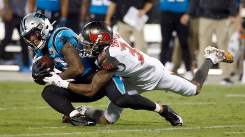 <p>               Carolina Panthers wide receiver D.J. Moore (12) is tackled by Tampa Bay Buccaneers cornerback Carlton Davis (33) during the first half of an NFL football game in Charlotte, N.C., Thursday, Sept. 12, 2019. (AP Photo/Brian Blanco)             </p>