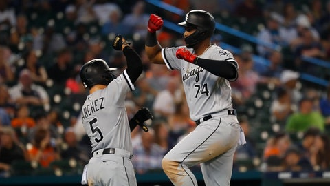 <p>               Chicago White Sox's Eloy Jimenez (74) celebrates his grand slam with Yolmer Sanchez (5) during the fourth inning of the team's baseball game against the Detroit Tigers in Detroit, Friday, Sept. 20, 2019. (AP Photo/Paul Sancya)             </p>
