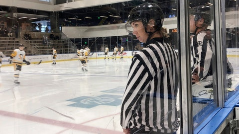 <p>               Linesman Kirsten Welsh watches at center ice as Pittsburgh Penguins and Boston Bruins players take the ice to prepare to play in the Sabres prospects hockey tournament, Friday, Sept. 6, 2019, in Buffalo, N.Y. Welsh is one four female officials selected to be the first women to work as on-ice officials at several prospect tournaments taking place across the country this weekend. The other three other women selected were Katie Guay, Kelly Cooke and Kendall Hanley. (AP Photo/John Wawrow)             </p>