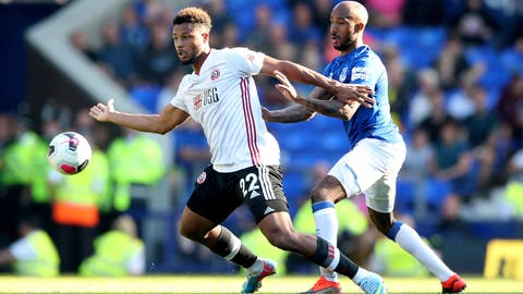 <p>               Sheffield United's Lys Mousset, left, and Everton's Fabian Delph battle for the ball during the English Premier League soccer match at Goodison Park, Liverpool, England, Saturday Sept. 21, 2019. (Nick Potts/PA via AP)             </p>