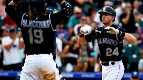 <p>               Colorado Rockies' Ryan McMahon (24) celebrates with Charlie Blackmon (19) after hitting a home run against the San Diego Padres in the third inning of a baseball game Sunday, Sept. 15, 2019, in Denver. (AP Photo/Parker Seibold)             </p>
