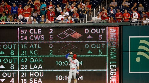 <p>               Philadelphia Phillies right fielder Bryce Harper gestures to spectators in the stands during the eighth inning of the team's baseball game against the Washington Nationals, Wednesday, Sept. 25, 2019, in Washington. (AP Photo/Patrick Semansky)             </p>