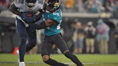 <p>               Jacksonville Jaguars cornerback Jalen Ramsey (20) stops Tennessee Titans tight end Delanie Walker (82) after a catch during the first half of an NFL football game Thursday, Sept. 19, 2019, in Jacksonville, Fla. (AP Photo/Phelan Ebenhack)             </p>