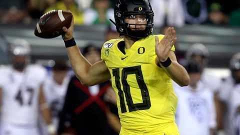 <p>               Oregon's Justin Herbert drops back to pass during the first quarter of an NCAA college football game against Montana Saturday, Sept. 14, 2019, in Eugene, Ore. (AP Photo/Chris Pietsch)             </p>