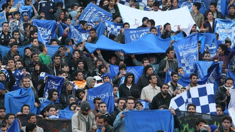 "<p>               FILE  - In this Dec. 9, 2011 file photo, supporters of Iranian soccer team Esteghlal, hold flags of their favorite team, at the Azadi (Freedom) stadium, in Tehran, Iran. Sahar Khodayari, an Iranian female soccer fan died after setting herself on fire outside a court after learning she may have to serve a six-month sentence for trying to enter a soccer stadium where women are banned, a semi-official news agency reported Tuesday, Sept. 10, 2019. The 30-year-old was known as the ""Blue Girl"" on social media for the colors of her favorite Iranian soccer team, Esteghlal. (AP Photo/Vahid Salemi, File)             </p>"