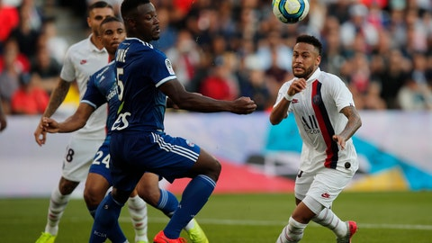 <p>               PSG's Neymar, right, vies for the ball with Strasbourg's Lamine Kone during the French League One soccer match between Paris Saint Germain and Strasbourg at the Parc des Princes Stadium in Paris, France, Saturday Sept.14, 2019. (AP Photo/Francois Mori)             </p>
