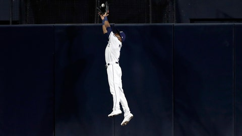 <p>               San Diego Padres center fielder Manuel Margot makes the catch above the wall for the out on Chicago Cubs' Nicholas Castellanos during the fourth inning of a baseball game Wednesday, Sept. 11, 2019, in San Diego. (AP Photo/Gregory Bull)             </p>